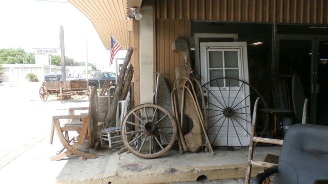 Antique Store In Labelle Florida. Wagon Wheels and Ox harness
